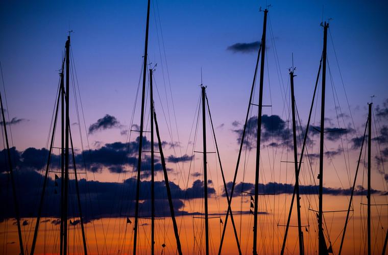 Boat masts at sunset