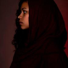 Muslim girl in red in profile