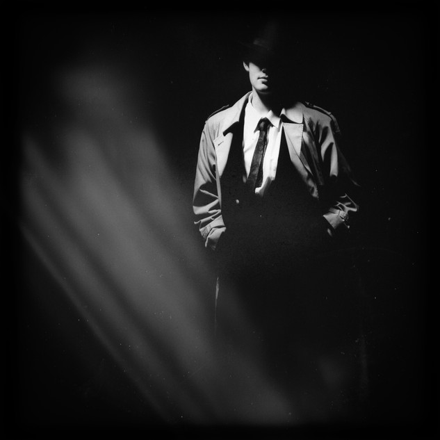 Detective in the shadows