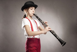 little-girl-playing-clarinet-00003497018