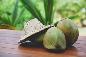 Coconuts with palm woven hat