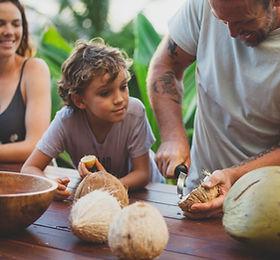 Children open coconut meat