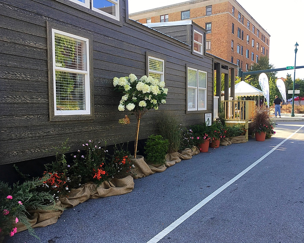 Flowering trees and shrubs at Simple Life's model tiny home at the North Carolina Apple Festival in Hendersonville