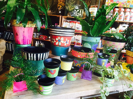 Colorful pottery mixed with houseplants