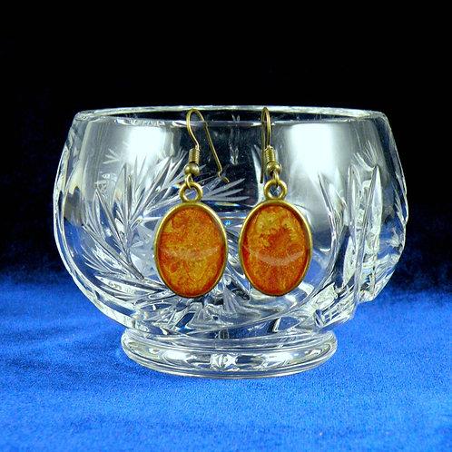 Boucles d'oreilles ovales à cabochons rouge-doré