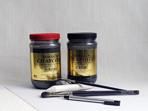 Les poudres de graphite et de charcoal en dessin