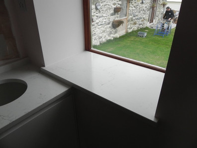 Windowsill out of Unistone Carrara Misterio Quartz