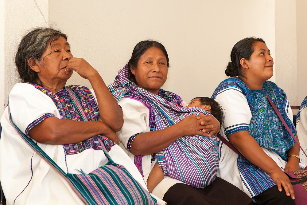Maria, the midwife in the middle, with her young son