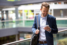 Businessman reading email on smartphone