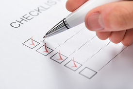 Man checking off items on a checklist