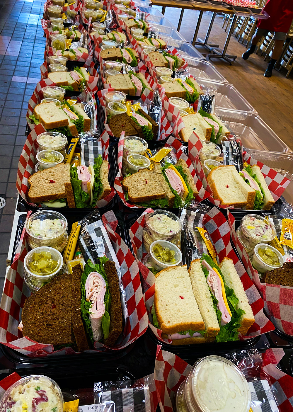 Boxed lunches waiting for the last touch of love before being sent out