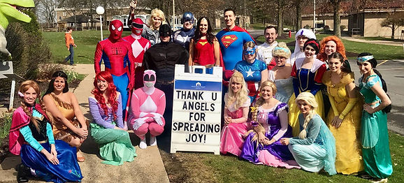 A group of performers dressed as superheroes and fairy tale characters