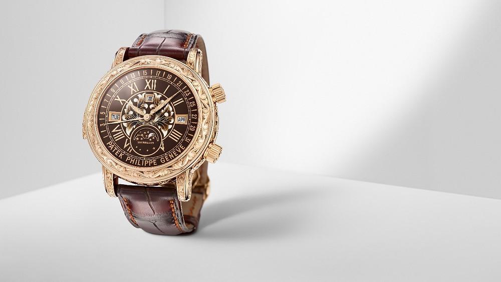 Ref. 6002R-001日月陀飛輪腕錶 by PATEK PHILIPPE。