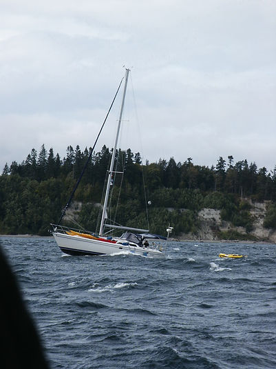 Solaria crashes thru swell on way to rendezvous, photo by S. Hurt