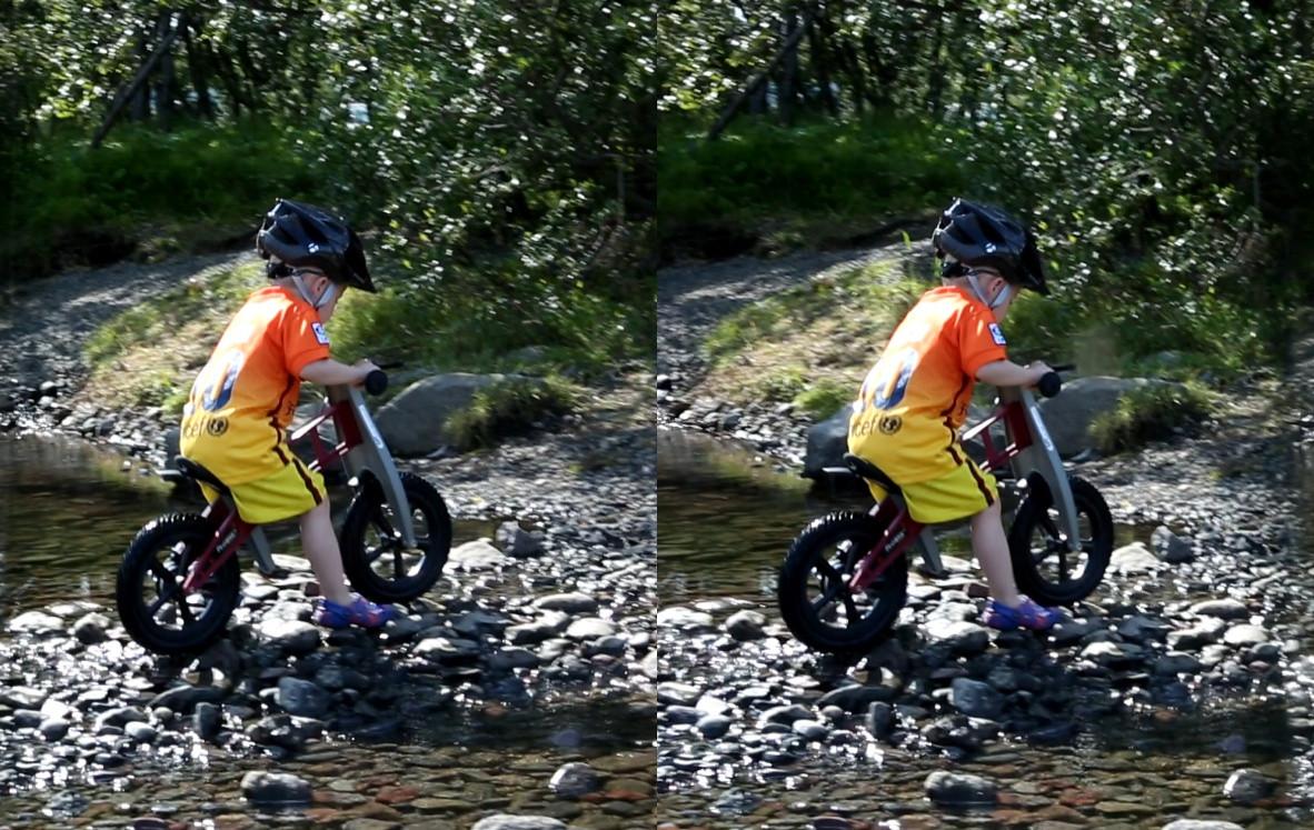 Atlavík - Hallormsstaðaskógur - a boy riding a bike - cross-eye