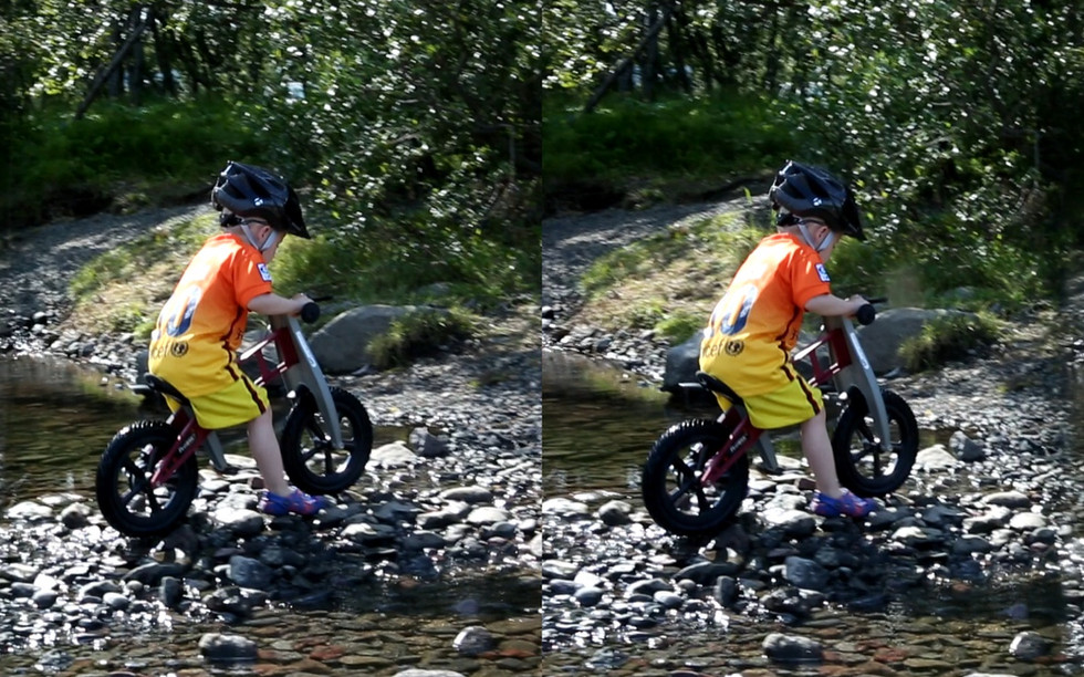 Stereoscopic image of a boy on his bike.
