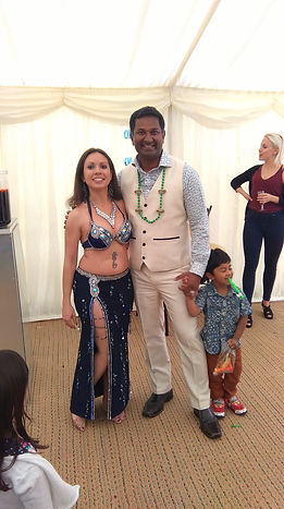 Elisa belly dance posing for pictures with client after performing at a 40th birthday party in Ascot