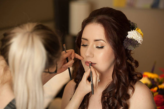 Emma getting ready in Abergavenny for her weddig day. I was the makeup artist who travelled to the hotel she was gettng ready at. A very calm and enjoyable experience