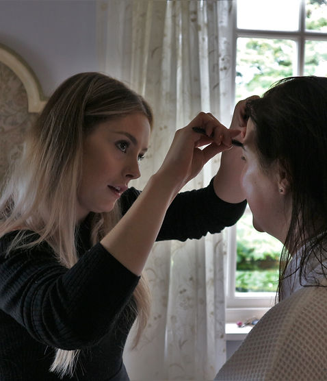 Makeup Artist in action at wedding. Bridal Party getting Makeover but Cinzia