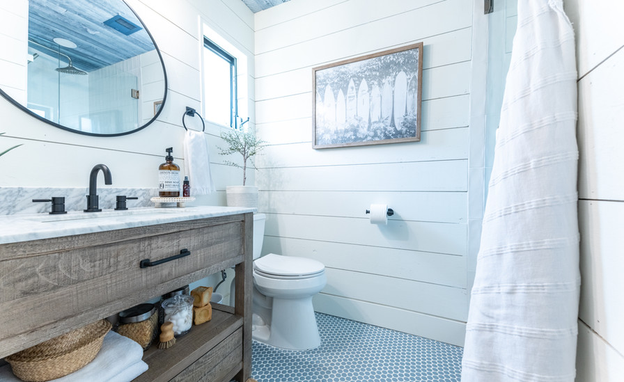 Shiplap adds a coastal feel and the penny tile adds a fun pattern.