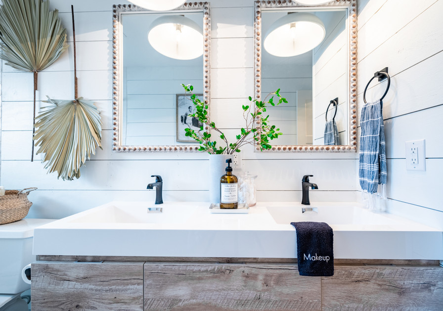 Driftwood vanity and mirrors add warmth and texture
