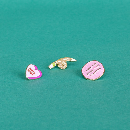 Enamel pins by Christina Lee