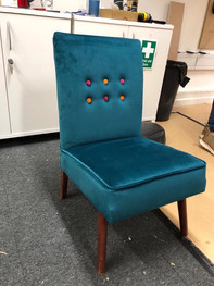 Buttoned back easy chair