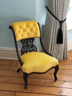 Antique button back chair