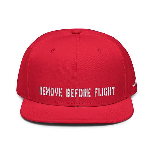 REMOVE BEFORE FLIGHT Snapback Hat