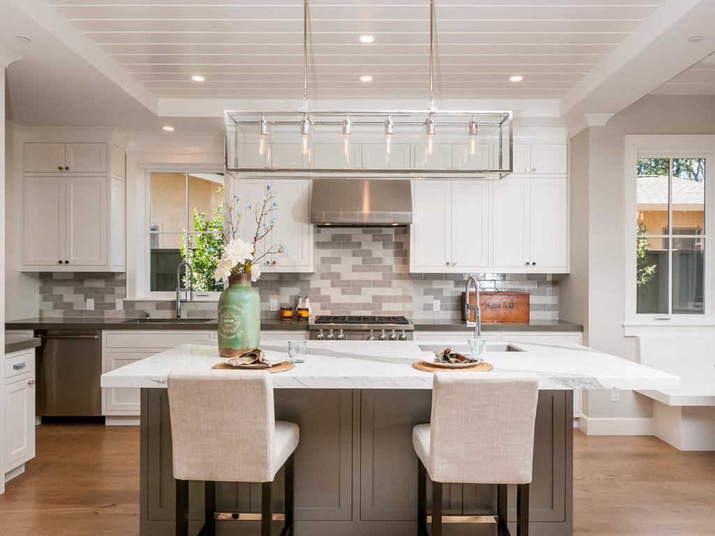 vase-linear-pendant-light-casual-elegance-windows-white-kitchen-counter-stools-neutral
