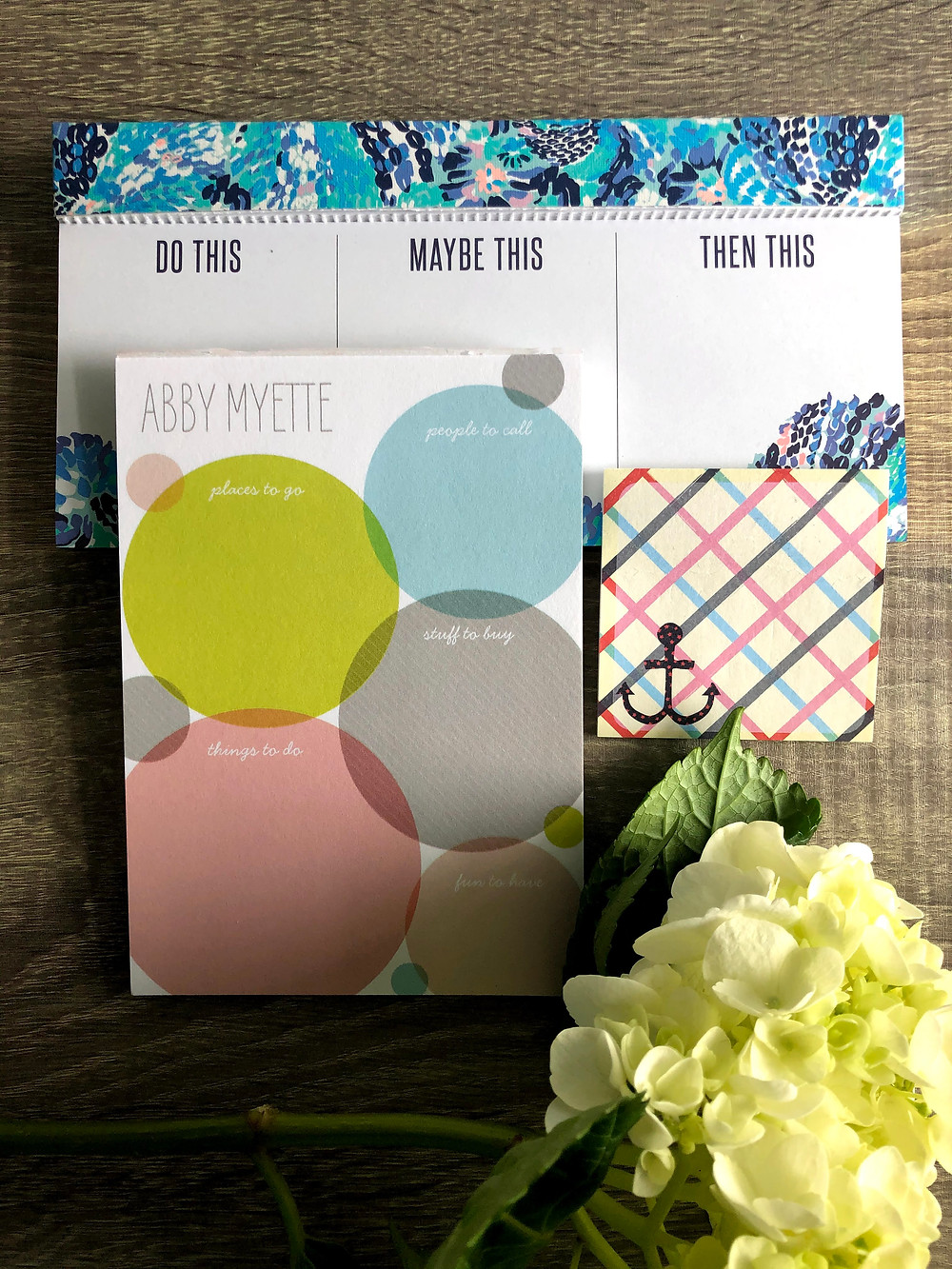 Three different notepads for organizing tasks.