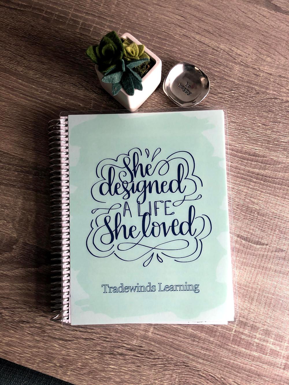 goal setting journal on desk