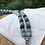 Thumbnail: Labradorite and Jasper 108 Bead Mala Necklace with Sterling Silver Feather Charm