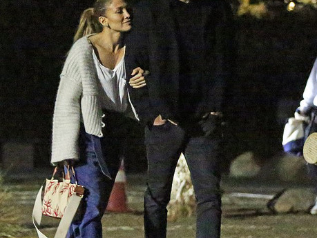 J Lo holds onto Affleck during an outdoor movie night with their kids