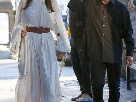 Angelina Jolie looks stunning in a white dress and shawl