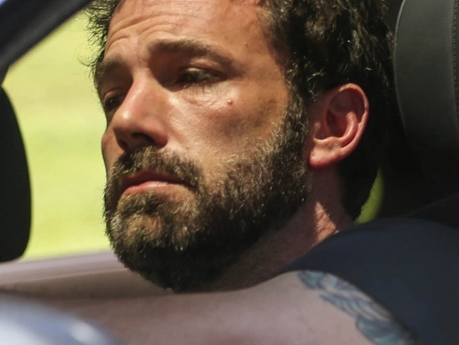 Affleck looking down in the dumps as he leaves J Lo's home this weekend