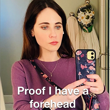 Zooey Deschanel looks unrecognisable and proves she has a forehead in a new picture without bangs