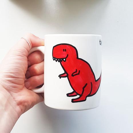 Red trex mug hand.jpg