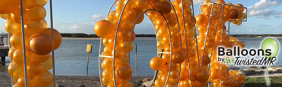 geo-letters-organic-balloon-garland.jpg