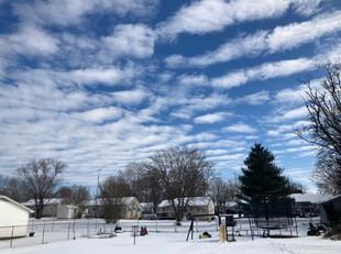 Clouds above, snow below.