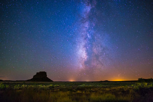 Anyone else daydreaming about going someplace completely different but with the same magical sky?   The Milky Way rises above Fajada Butte in Chaco Culture National Historical Park, New Mexico.