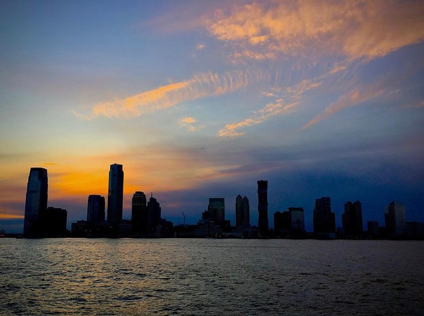 On this damp & dark New Year's Eve, posting some of my favorite sunset pics of the year, beginning with a view of Jersey City from Lower Manhattan (pre-pandemic).