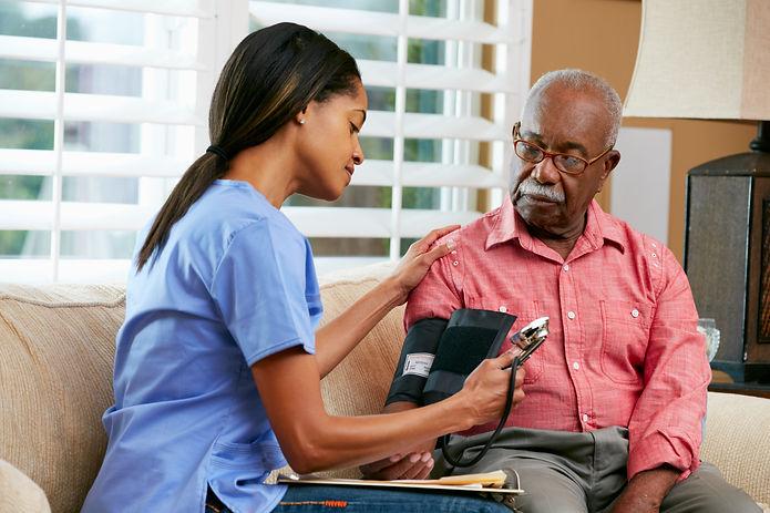Nurse Visiting Senior Male Patient At Ho