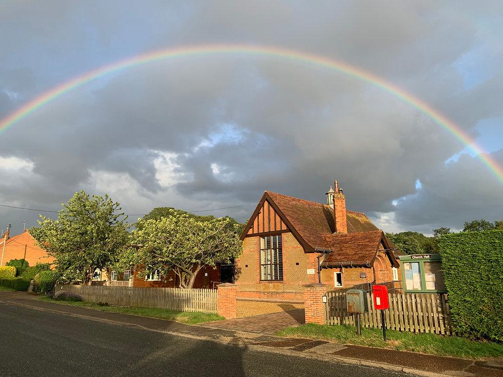 Ingoldisthorpe Church Hall with rainbow framing it 2020