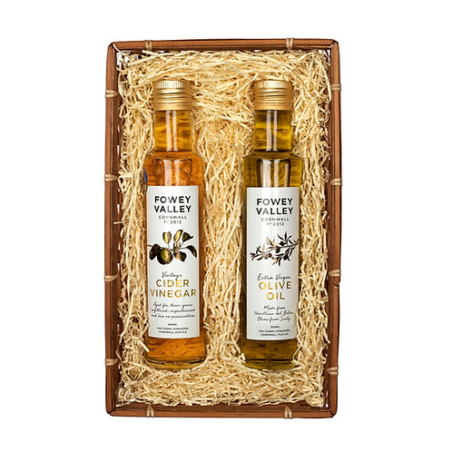 250ml bottle each of vintage cider vinegar and extra virgin olive oil in bamboo tray with straw