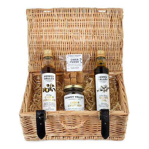 small wicker hamper containing, oil, vinegar, cider fudge and cider chutney
