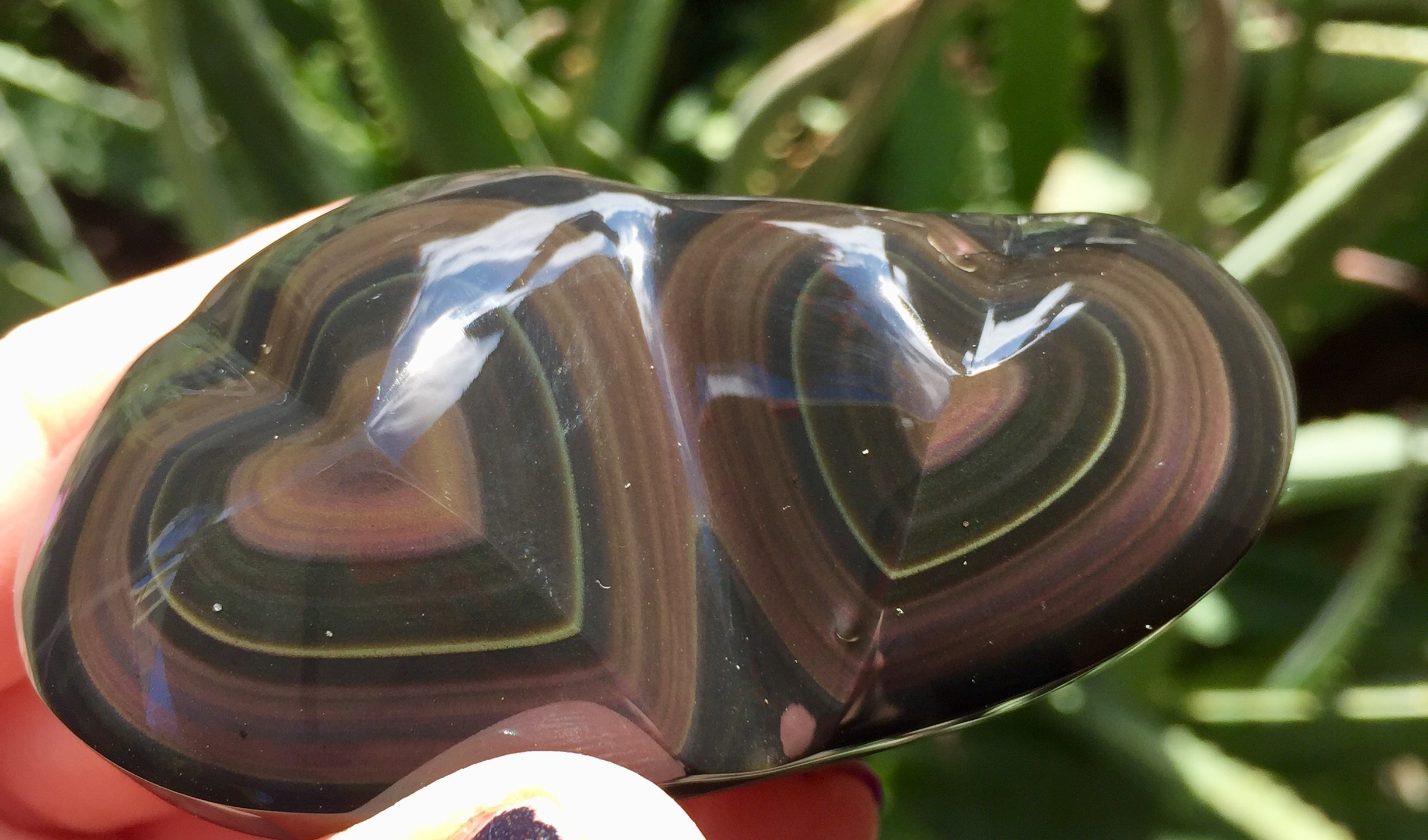 I LOVE hearts!! So to find these carved Rainbow Obsidian hearts made my day!