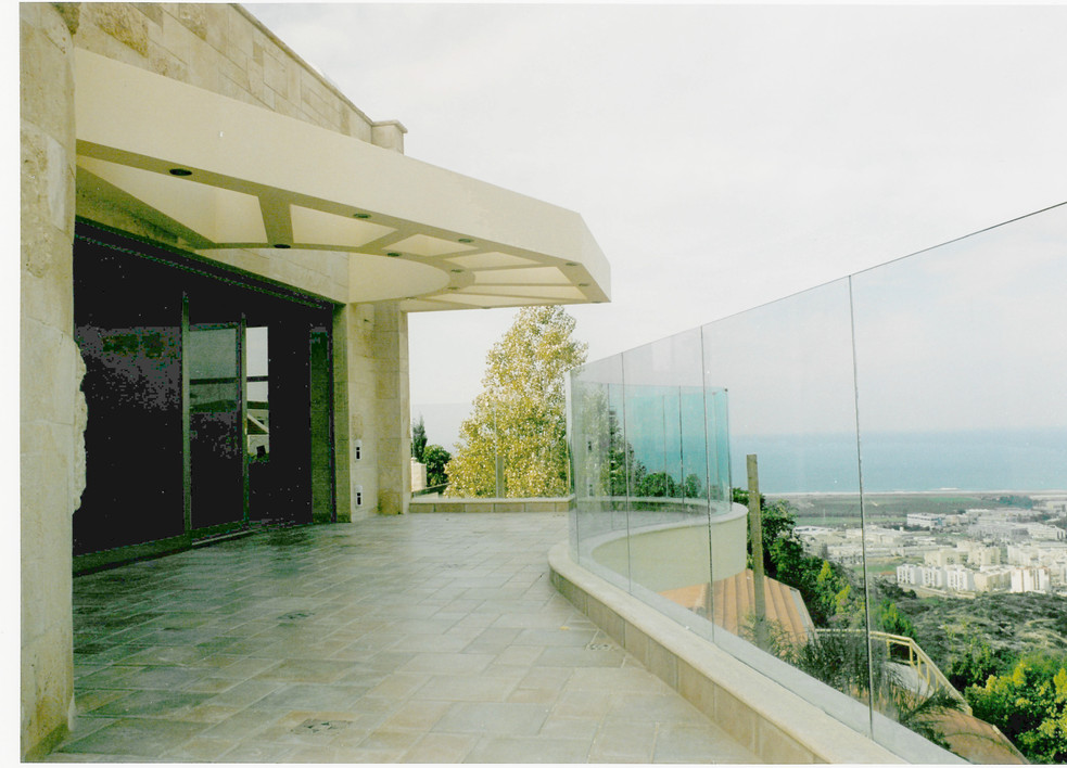 Curve Glass Railing At Balcony Watching