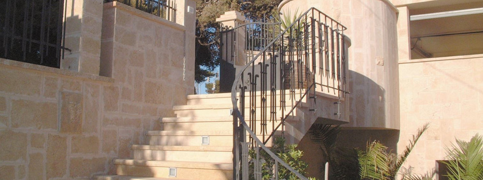 IRON RAILING DETAIL AT ENTRANCE STAIRS D