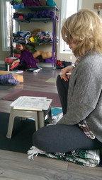 Yoga Teacher reading handouts